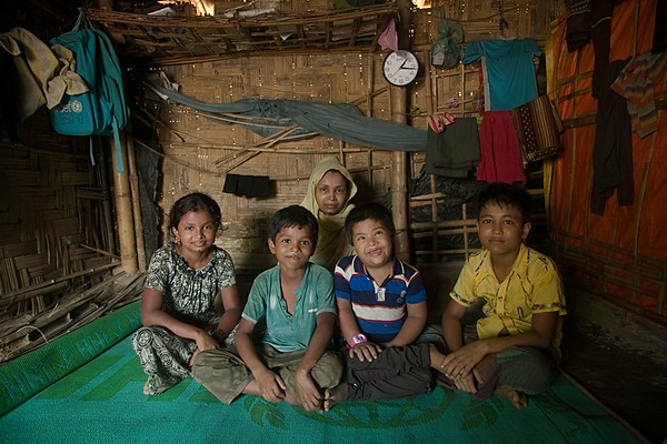 "UNICEF-RR-0224 -0229  MD Jia (12) accompanied by his mother Ayeasha (34), sister Mawa, brother Hazia and Nur Habib (mentally disable) who loves his elder brother Jia very much.    MD JIA, 12 ""I want education. I want to study in high school so that one day I could be a doctor. This is my one and only dream. But I don't know how to fulfill it. I am over qualified for BRAC learning centre and they referred me to another school which is yet to establish. I along with my mother and six siblings fled from Myanmar and lost our father on the way in hill. I am running a small shop to earn some money. and to set up the shop my mother was forced to vend her ear rings. Due to my mother's age limit we didn't receive any LPG and we collect relief cloths, plastics and branch of tree from different camps to use as fuel to cook food regularly. My younger sister was seriously ill due to plastic smoke during cooking. We are living a miserable life here. We are refugee here and I don't want to keep this status anymore. I definitely want to go back my country one day"".  Address in Myanmar: 100, Akyab, Buthidoung, Myanmar.  Camp Address: H - 0626, Block A-7, Camp 16, Shofiullah Kata,  Ukhiya, Cox's Bazar.  Photo: b.a.sujaN / UNICEF / Map"