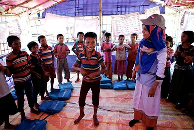 0111-0113  Mohammad Sabbir, a 13-year-old disabled Rohingya child, attends classes at a UNICEF-supported learning centre at the Balukhali makeshift settlement for Rohingya refugees in Ukhia, Cox's Bazar, Bangladesh.     Photo: UNICEF / b.a.sujaN/Map