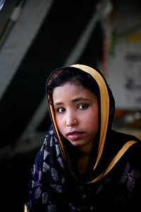 0236-0272  Fatema and Rozina became orphans after they lost their parents and two younger siblings when their boat capsized while crossing the water from Myanmar to Bangladesh. They are now the adopted daughters of Rafiq majhee, a community leader at a refugee camp. Rafiq has his own share of tragedy as he lost his only child – a seven-year old son – in the same sunken boat.  Photo: UNICEF / b.a.sujaN / Map
