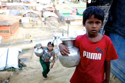 0334-0339 Aktara - (7), Studying at a BRAC School. Aktara collects water every day at least three to five times a day from a tube-well (water well using hand pump) and carries to pots to her makeshift home located at an uphill area. She attends a UNICEF-supported learning centre in a Rohingya refugee makeshift settlement.  Father Patang Sikder (45), Mother Hasina Begum (40), 6 sisters & brothers. BUrma address- Nurpur village, Mondu district, BUrma. Photo: UNICEF/b.a.sujaN/Map