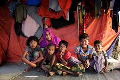0340-0344 Aktara - (7) Family Photos with 3 brothers and two sisters. Aktara collects water every day at least three to five times a day from a tube-well (water well using hand pump) and carries to pots to her makeshift home located at an uphill area. She attends a UNICEF-supported learning centre in a Rohingya refugee makeshift settlement.  Photo: UNICEF/b.a.sujaN/Map