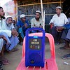 0372-0393<br /> Senior citizens of Rohingya refugee community are listening to the latest news from Myanmar. This communications device has been provided by UNICEF to give the refugees a chance to know updates from their homeland. <br /> Tajimerkhola, Burmapara. Cox's Bazar, Ukhiya,<br /> Photo: UNICEF / b.a. sujaN / Map