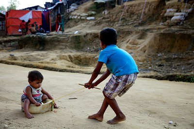 0462-0466  Noor, 7, plays with his one-year-old sister at the Thaingkhali makeshift settlement in Ukhia, Cox's Bazar, Bangladesh.  Photo: UNICEF / b.a.sujaN / Map