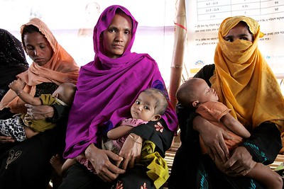 0568-0572  Rohingya mothers wait at an OTP center for treating children suffering from Severe Acute Malnutrition at Unchiprang makeshift refugee settlement in Teknaf, Cox's Bazar, Bangladesh.    Photo: UNICEF/b.a.sujaN/ Map