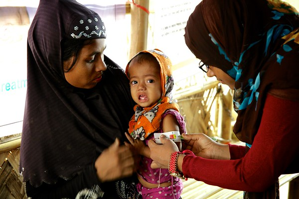 0556-0558  Rohingya refugee children, between 6 weeks and 6 years of age, get diphtheria vaccines at Bormapara in Bangladesh's Cox's Bazar district as part of UNICEF's effort to protect them from preventable diseases.       Photo: UNICEF/b.a.sujaN/ Map