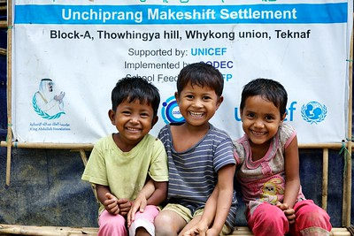 0580-0586  Children pose outside UNICEF's Kokil Learning Center for Rohingya refugee at Unchiprang makeshift settlement in Teknaf, Cox's Bazar, Bangladesh.    Photo: UNICEF / b.a.sujaN/Map