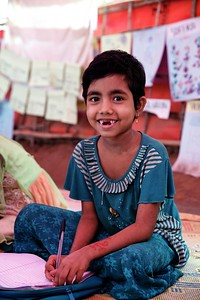 0589-0591  Sofiat, a 7-year-old Rohingya refugee child, poses for a photograph during her lessons at UNICEF's Kokil Learning Centre at the Unchiprang makeshift settlement in Teknaf, Cox's Bazar, Bangladesh.    Photo: UNICEF / b.a.sujaN/Map