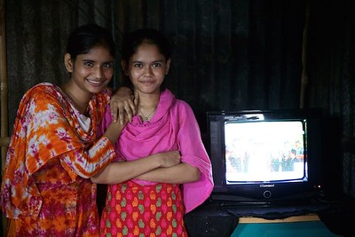 0048 Julakha (13 years old) studying in class 4.  With pink Orna right side standing with sister. Living with single mother & a sister but she has more 2 brothers & 3 Sisters. Her father left them 2 years ago and got marride again. One and half years ago they came to dhaka because of river erosion from Bhola (a island from delta)  Bhola Bosti(Slum), pallobi, Mirpur, Dhaka. Bangladesh.  Photo: sujaN/UNICEF/Map www.sujanmap.com