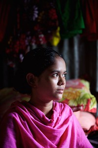 0049-0057 Portrait of Julakha. Julakha (13 years old) studying in class 4.  Living with single mother & a sister but she has more 2 brothers & 3 Sisters. Her father left them 2 years ago and got marride again. One and half years ago they came to dhaka because of river erosion from Bhola (a island from delta)  Bhola Bosti(Slum), pallobi, Mirpur, Dhaka. Bangladesh.  Photo: sujaN/UNICEF/Map www.sujanmap.com
