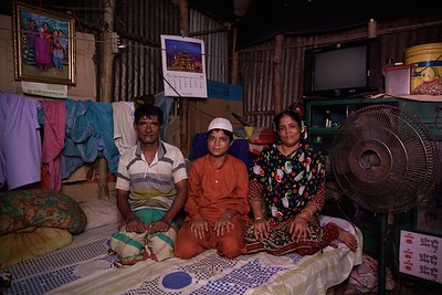 0031-0033 Ibrahim (13 years old) studying in residentioal Madrasa in class 5. (a arabic education school)   Living with parents, one brothers & one Sisters. Her parents came to dhaka few years ago because of river erotion from Bhola (a island from delta)  He is one of the benifesherys of conditional cash transfer program by UNICEF & GOV Depertment of Social Services.  Bhola Bosti(Slum), pallobi, Mirpur, Dhaka. Bangladesh.  Photo: sujaN/UNICEF/Map www.sujanmap.com