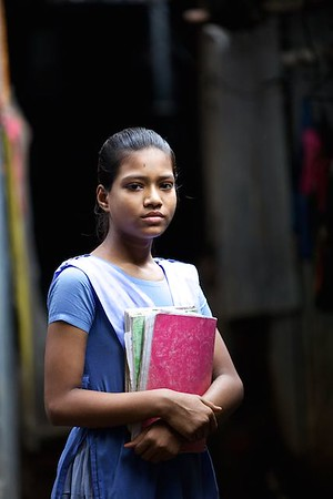 0020-0030 Portrate of Sathi Akter after coming from School. Sathi Akter (12 years old) Studying in class 4. Living with parents, 2 brothers & 2 Sisters. Parents came to Dhaka 2 years back because of river erotion from Bhola (a island from delta)  Bhola Bosti(Slum), pallobi, Mirpur, Dhaka. Bangladesh.  Photo: sujaN/UNICEF/Map www.sujanmap.com