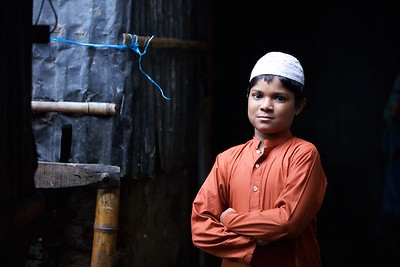 0034-0037 Portrate of Ibrahim Ibrahim (13 years old) studying in residentioal Madrasa in class 5.(a arabic education school)   Living with parents, one brothers & one Sisters. Her parents came to dhaka few years ago because of river erotion from Bhola (a island from delta)  He is one of the benifesherys of conditional cash transfer program by UNICEF & GOV Depertment of Social Services.  Bhola Bosti(Slum), pallobi, Mirpur, Dhaka. Bangladesh.  Photo: sujaN/UNICEF/Map www.sujanmap.com