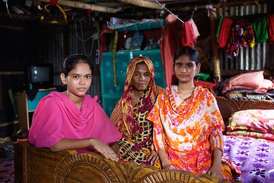 0043-0044 Julakha (13 years old) studying in class 4.  With pink Orna Left side sitting is Julakha. Living with single mother & a sister but she has more 2 brothers & 3 Sisters. Her father left them 2 years ago and got marride again. One and half years ago they came to dhaka because of river erosion from Bhola (a island from delta)  Bhola Bosti(Slum), pallobi, Mirpur, Dhaka. Bangladesh.  Photo: sujaN/UNICEF/Map www.sujanmap.com