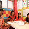 0061<br /> <br /> The teacher & the students are discussing & listening to the UNICEF representatives inside their classroom.<br /> <br />  Credit: © UNICEF/BANA2016/Sujan