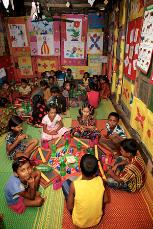 0011-0027  The children of BRAC School that is run by Shishu Academy and Funded by UNICEF, are writing & learning Bangla alphabets & numbers, as well as doing activities such as dancing & singing.  Credit: © UNICEF/BANA2016/Sujan