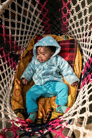 0001-0003 Said Islam Nirob (4 month) Cold Winter morning sleeping under the sun at village house Courtyard.  Hoglabunia Village, Dakua Union, Golachipa upozilla, Patuakhali district. Bangladesh.  Photo Credit: b.a.sujaN / Map / WRA