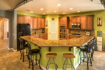 view 10  Exit kitchen and family great room area to the left straight down the hall to 3 bedrooms and two full bathrooms