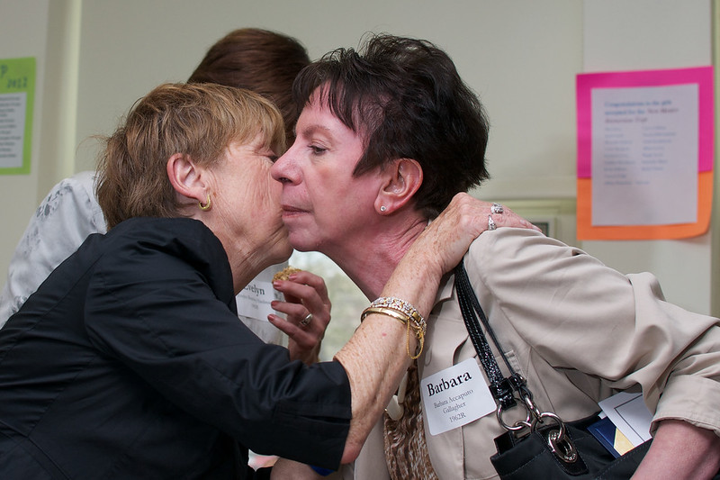 Jane Good Everette, left and Barbara Accaputo Gallagher, right, say goodbye.
