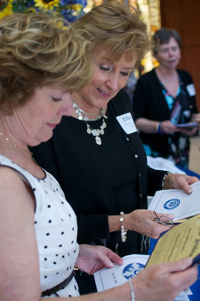 Patricia McCusker Bailey, and Ellen Coyne Leary, Class of 1962, hold their commemoritive Golden Diplomas