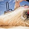 Quad bike speeding by on the sand