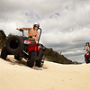 Man and woman on quad bikes