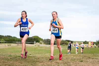 464 Zara Geddes second & 452 Stella Hammond third in the  U18  Women 6km during the 2021 New Zealand Cross Country Championships at Chisholm Links Golf Club, on the 7th of August 2021.  Mandatory Photo Credit: Clare Toia-Bailey / www.allisonimages.co.nz