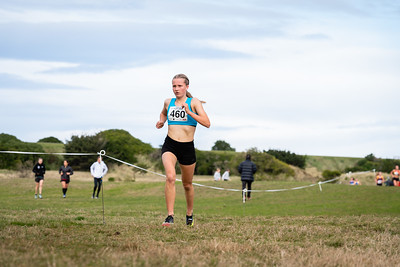 460 Bella Earl winner of the U18 Women 6km during the 2021 New Zealand Cross Country Championships at Chisholm Links Golf Club, on the 7th of August 2021.  Mandatory Photo Credit: Clare Toia-Bailey / www.allisonimages.co.nz