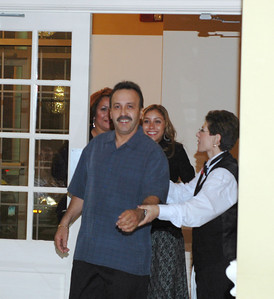 Suprise....Happy 50th.  My brother Jose Miguel Rios with his daughter Jackie and wife, Carmen behind him.