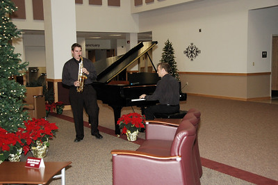 Andrew playing the Sax and Pastor Bob playing the piano.