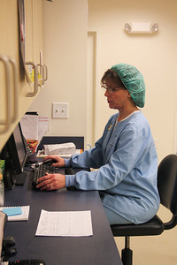 Darlene checks a patient's medical record.