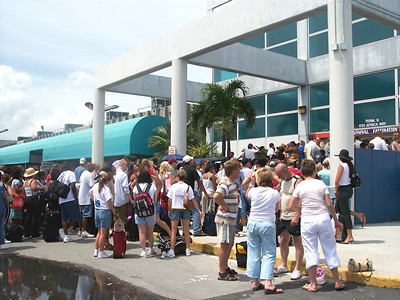 "Well...we get to the port and we can't believe our eyes.....the line to check in is outside.  We investigate and find out that they are not opening the doors till 3:00 p.m.  (that's the time we were suppose to set sail)  The heat was unbearable!!!!  I was starting to get in a bad mood.  They finally opened the doors at 4:00 p.m. and check-in was unbearable....people pushing and shoving and so much unpleasantries.  This was all due to the hurricane......everything was behind schedule (they ""omitted"" to tell us that part when we call to see if everything was on schedule :-( )  Anyway, we finaly got to our rooms around 6:00 p.m."