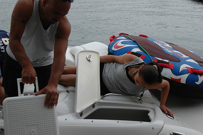Stacking the boat with drinking water.....it gets hot out there...yikes!!!