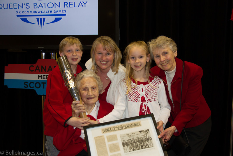 Violet Histed (nee Smith) holding the Queen's Baton with great grandson Trent Cardinal, grand-daughter Karen Bell-Cardinal, great grand-daughter Brooke Cardinal and daughter Marian Bell (nee Histed)