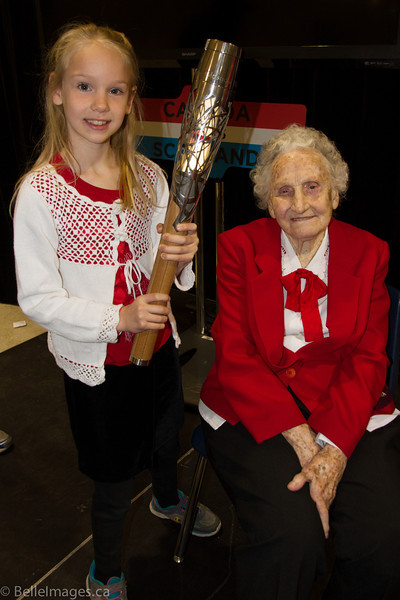 Violet Histed (nee Smith) with great grand-daughter Brooke Cardinal holding the Queen's Baton