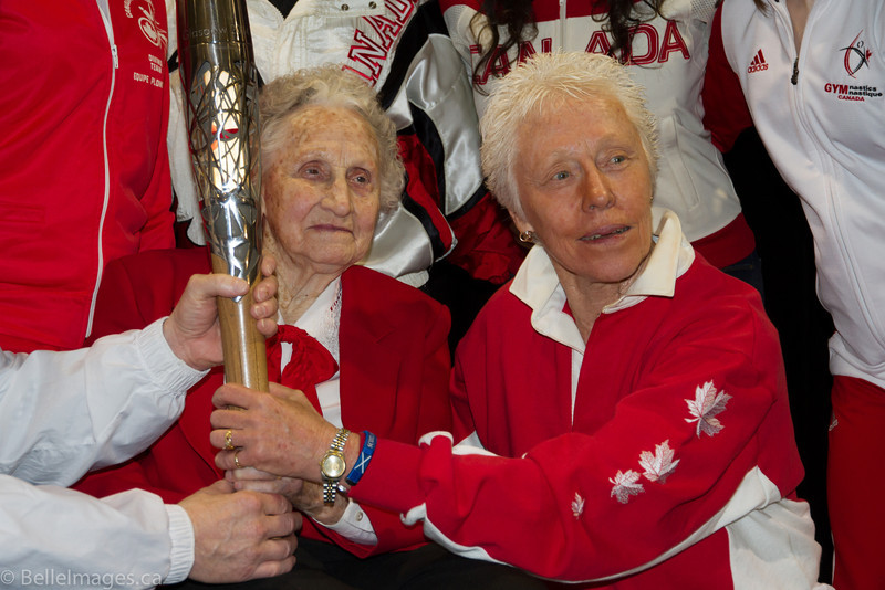 Violet Histed (nee Smith) and Cecelia Carter with the Queen's Baton