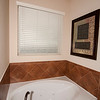 Jetted tub and frosted window in Master Bathroom 125 Lake Whitney Court, Georgetown, TX
