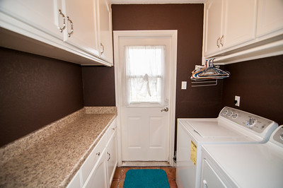 Laundry area off Master with doorway to outside