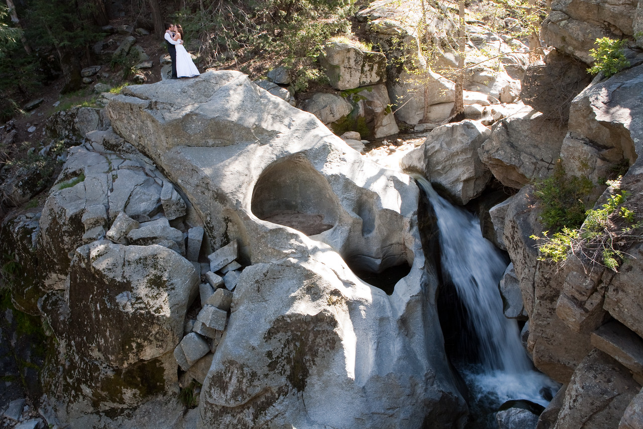 Taylor and Christina Rood were an amazing couple to shoot. They are from Corona California and are old friends of Larissa Anne Photography. Both Taylor and Christina have seen me grow through stages of my photography. Over a year before this shoot, my friend Russell and I went to Big Bear and found this waterfall. Both of us thought it was appropriate to take a bride and groom here for a trash the dress session. This waterfall in Big Bear, California has a natural heart located directly next to the waterfall.