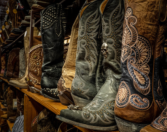 Ornately decorated cowboy boots seen at Allen's Boots on South Congress Avenue, Austin, Texas.