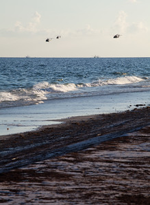 Choppers and skim boats. Taken 6-23-2010 on Pensacola Beach. The day the oil hit hard. Black Wednesday.