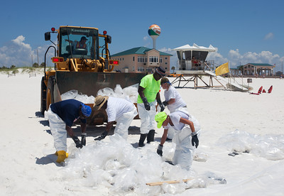 Clean up workers on Casino Beach. Taken 6-23-2010 on Pensacola Beach. The day the oil hit hard. Black Wednesday.