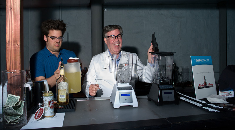 Tom Dickson of Blendtec gets ready to use his blending skills on margaritas, with assistance from Barry Anderson of the Parnassus Group.
