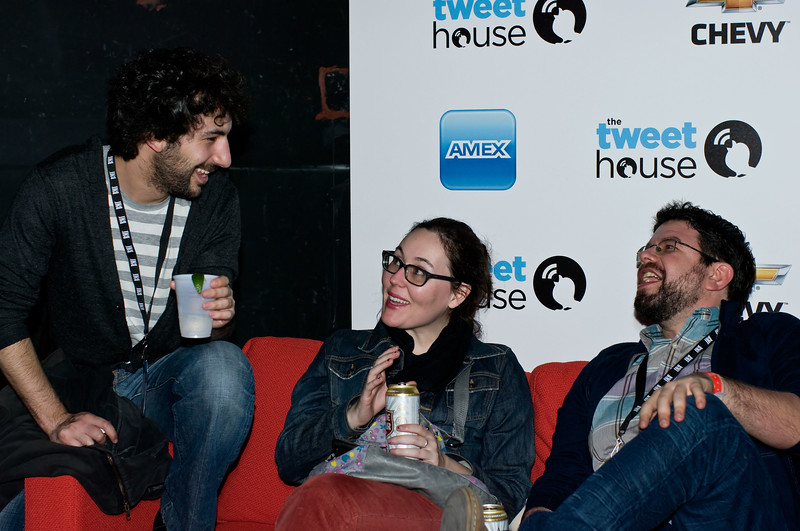 The red sofa was popular at the Tweet House SXSW 2011 party because it came with a view of the action.