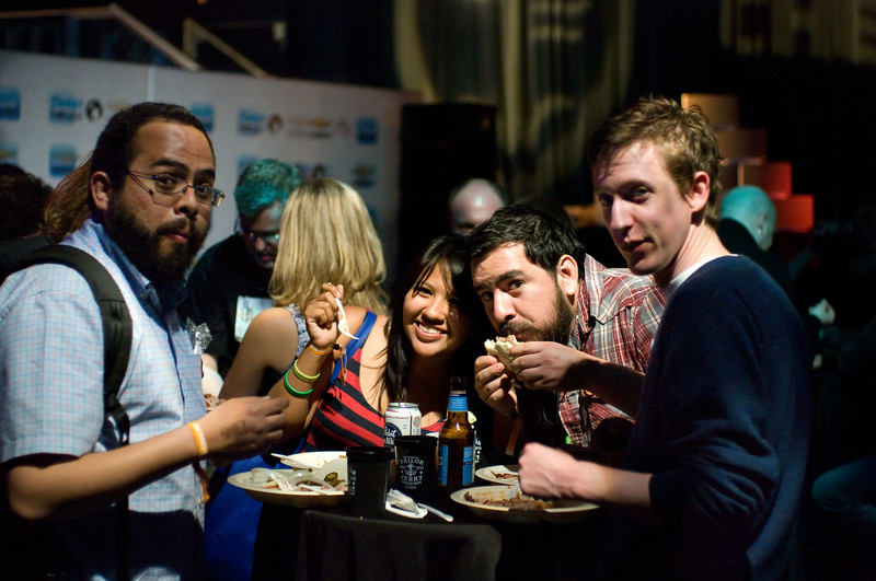 Party goers chow down at the Tweet House SXSW 2011 barbecue and party.