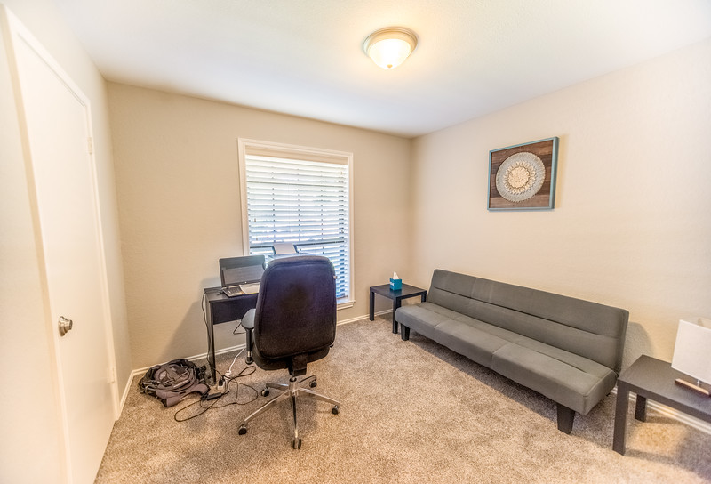 Office with printer and Sleeper Futon Sofa for more space far a large group.