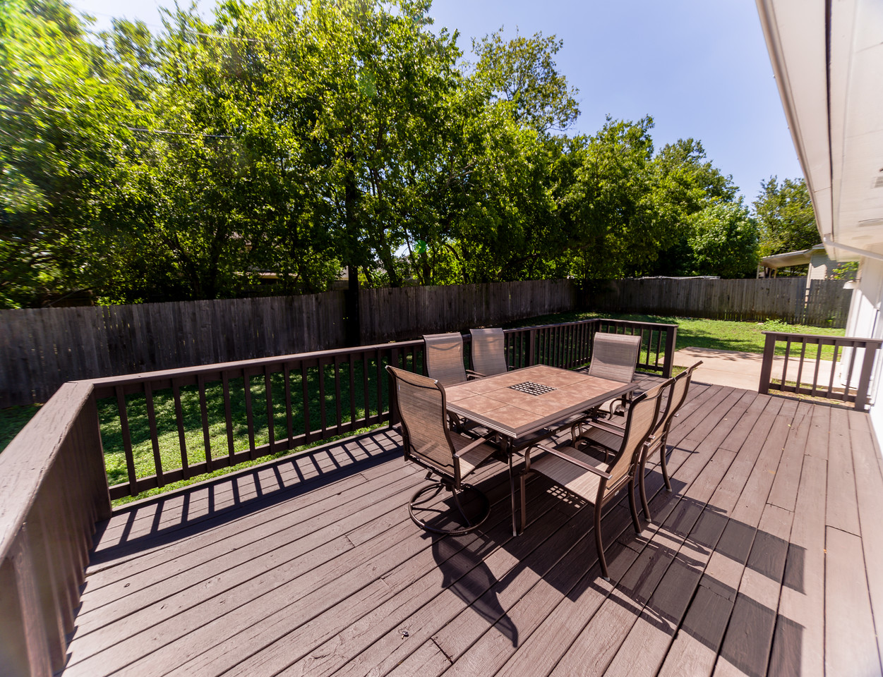 Backyard deck with room for many a good-times.