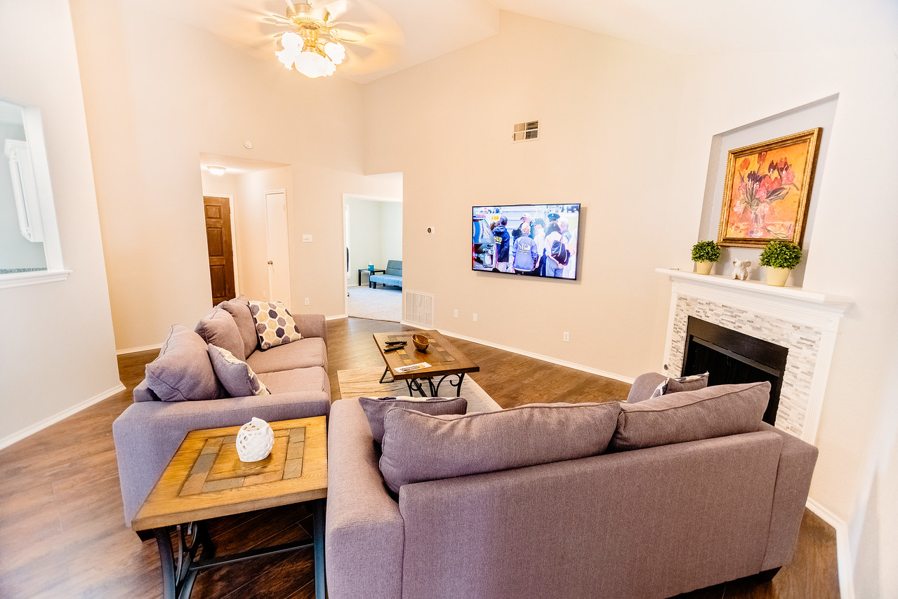 Living room, 65 inch HD Smart TV, w/Roku.