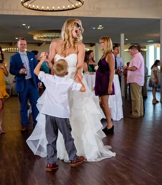 Bride dances with her son, who also escorted her down the aisle.