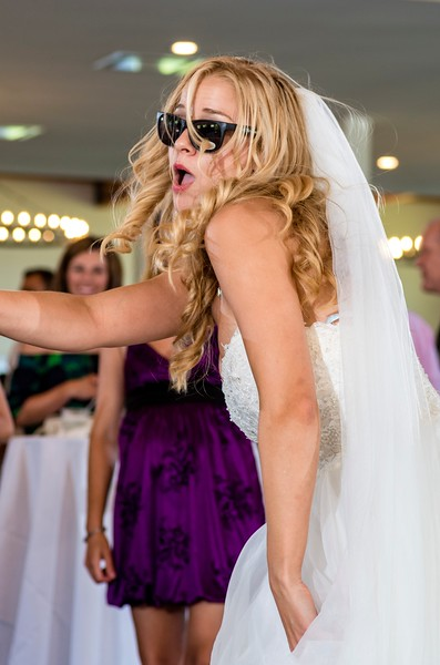 Mid-day ceremonies call for sunglasses, which the couple provided for their guests. The bride models them with great effect.