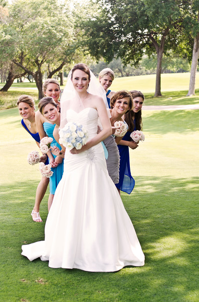Bride with bridesmaids on golf course.The Hills of Lakeway Resort, Austin, TX.